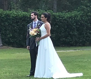 Cedar-Knoll-Events-FL-Bride and Groom standing outdoors holding bouquet