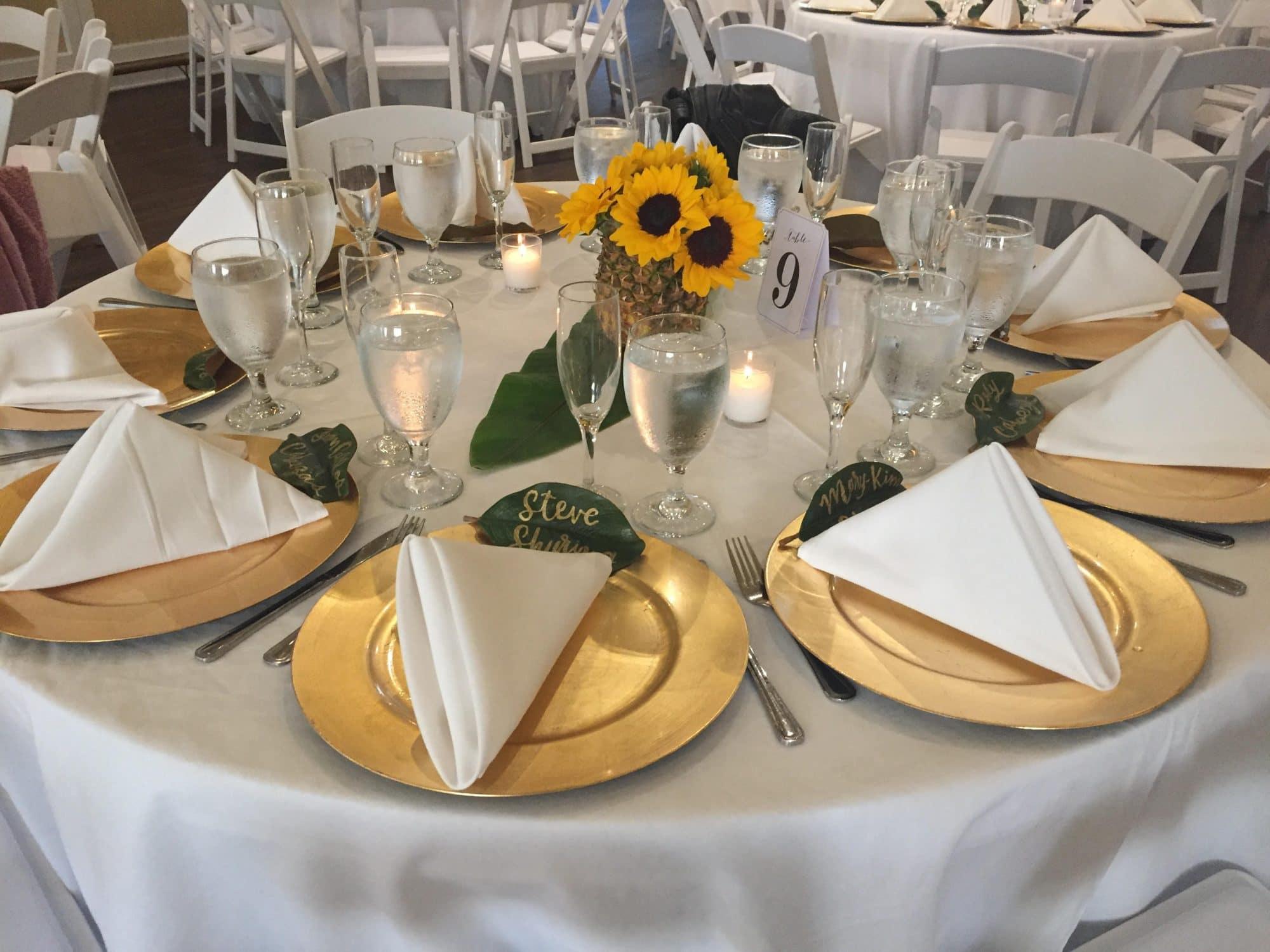 Celebration Golf Club - reception table with sunflower centerpiece