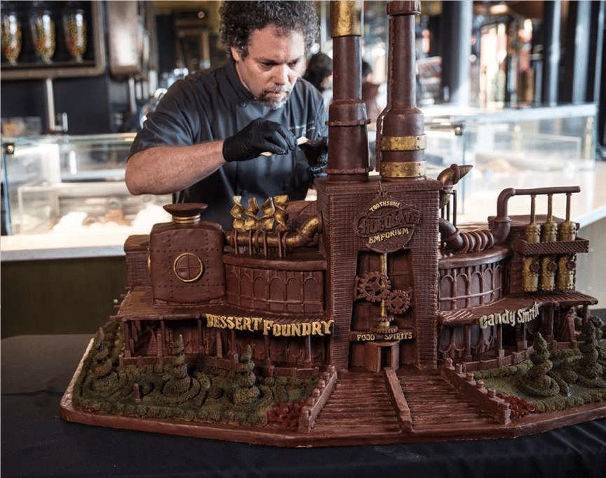 Chocolatier creating a giant model factory out of chocolate.