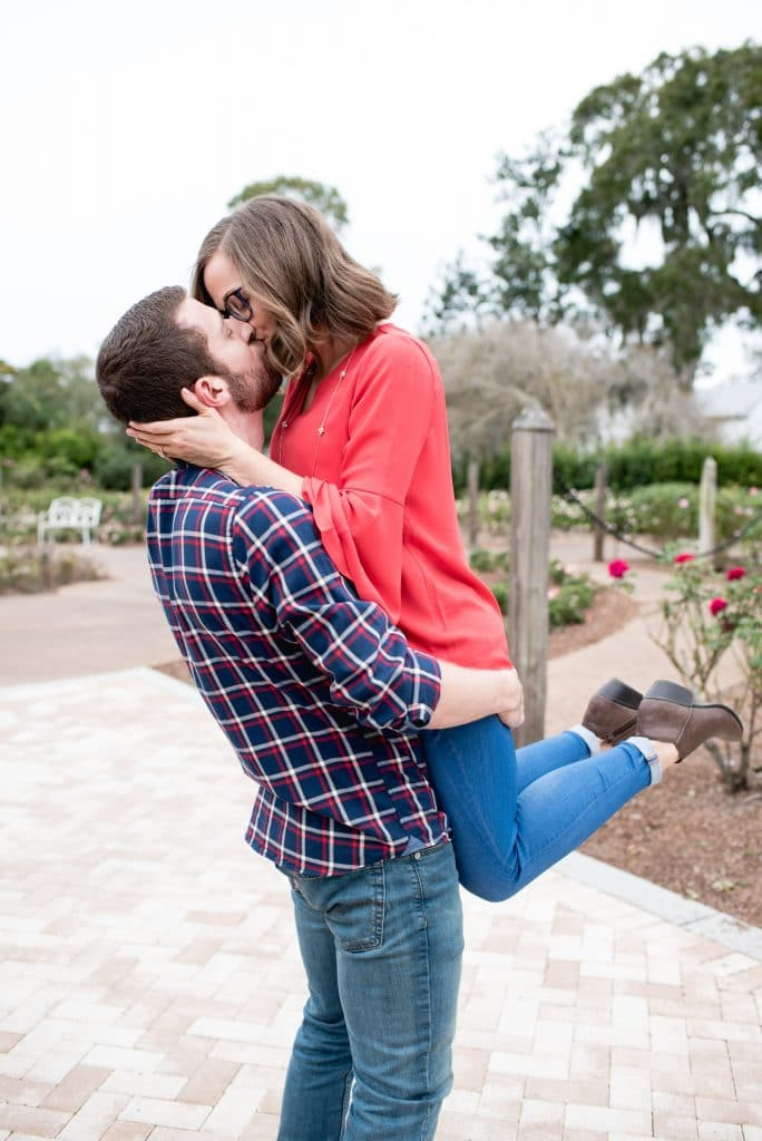 Embrace by Kara - engagement shoot of man lifting wife during kiss