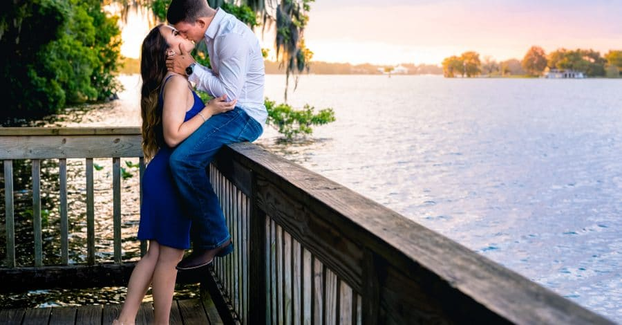 Embrace-by-Kara-Couple kissing on a dock at sunset