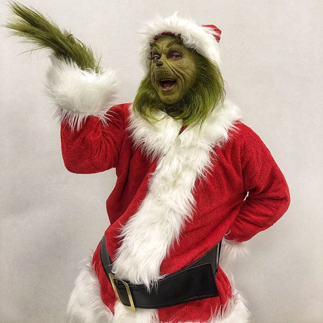The Grinch dressed in Santa outfit.