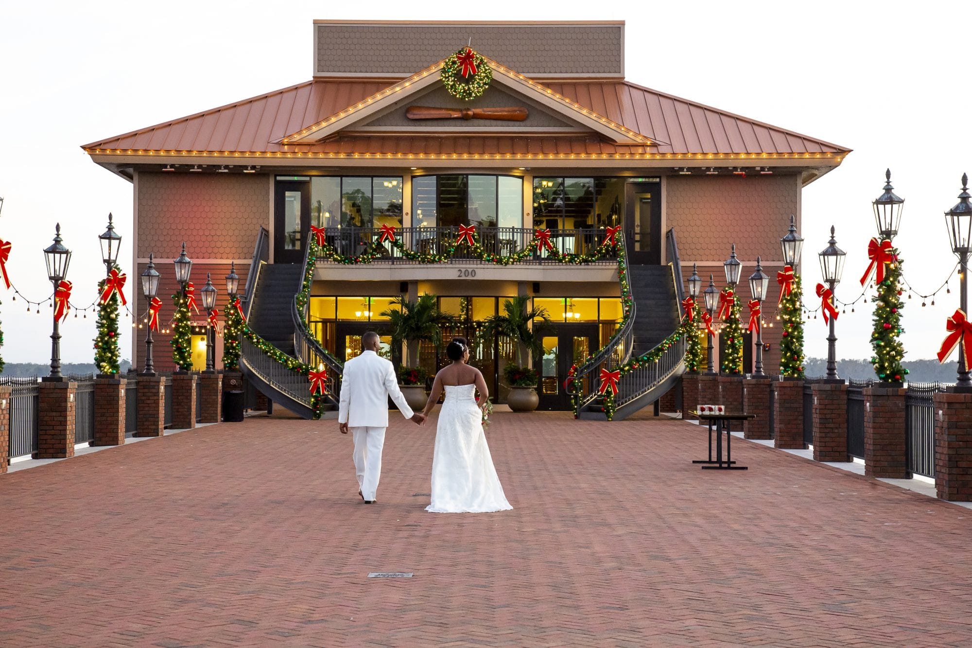 Shaneika and Richard in front of wedding venue