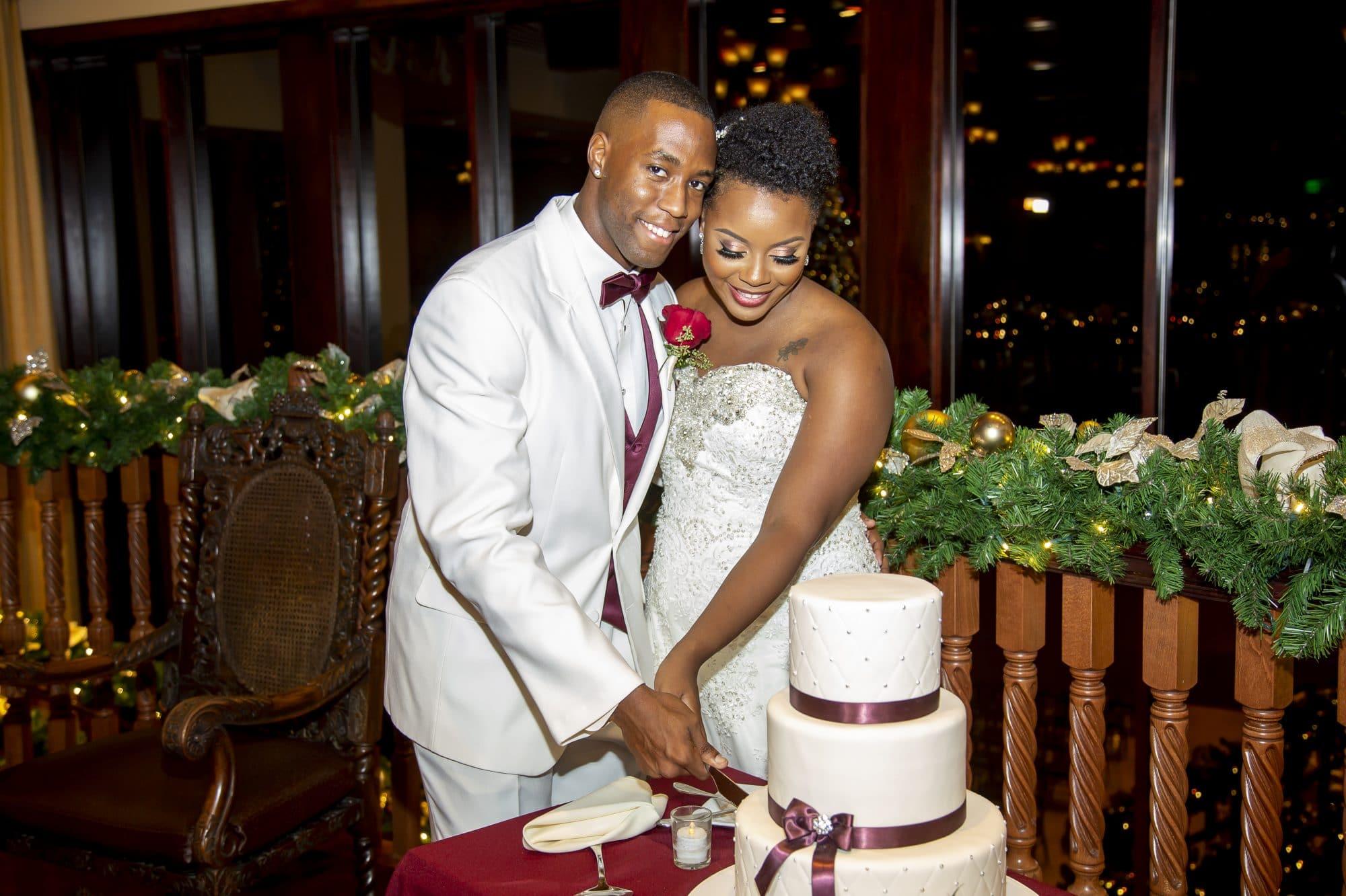 Shaneika and Richard cutting the cake