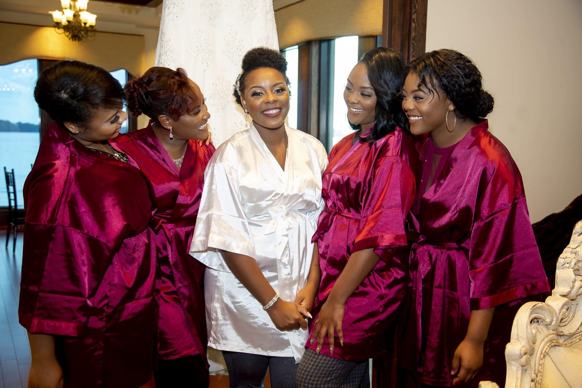 Shaneika and bridesmaids in coordinating satin robes