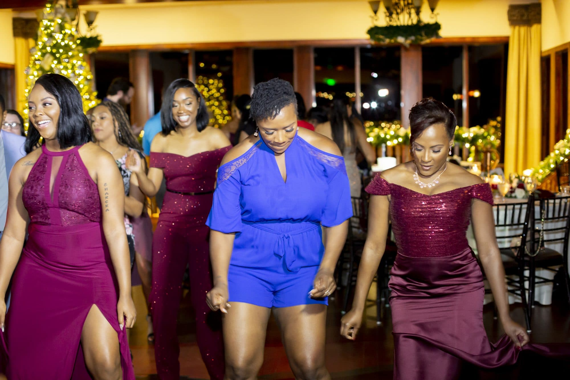 Wedding guests and bridesmaids on the dance floor