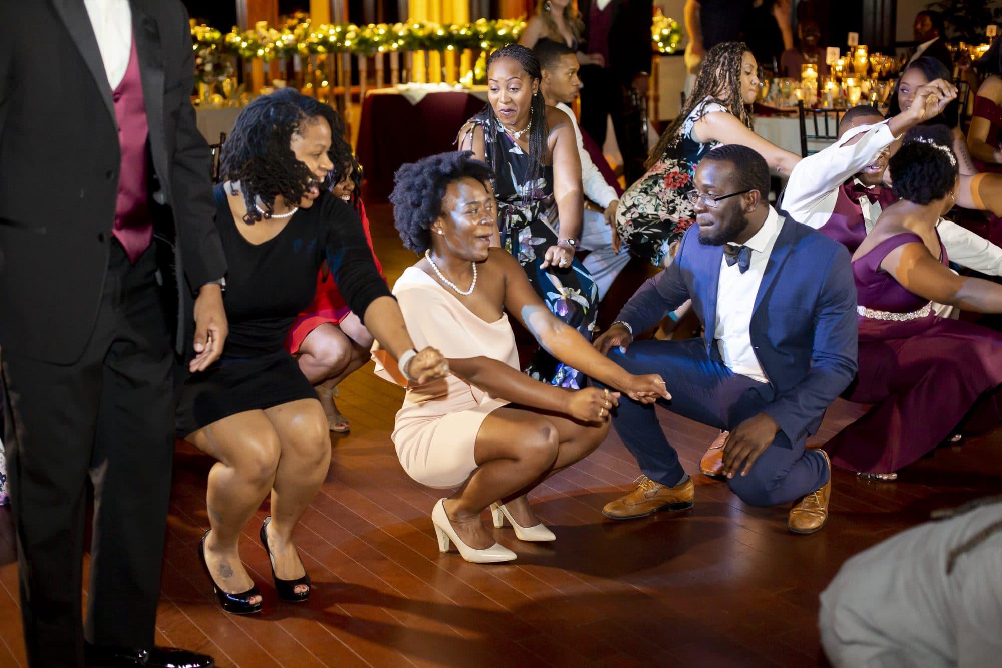 """Wedding guests """"get low"""" on the dance floor!"""