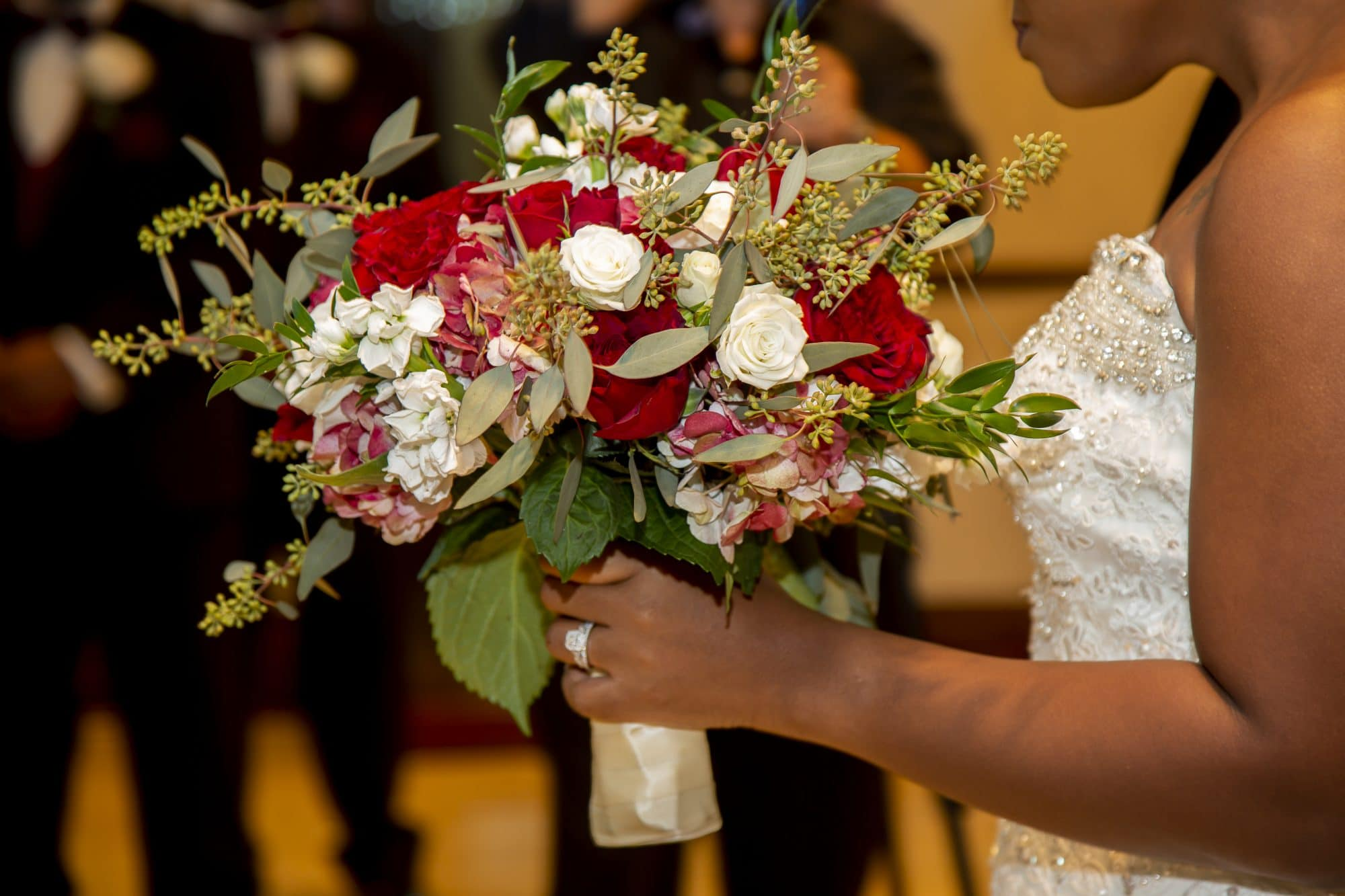 Shaneika holding beautiful white and red bouquet