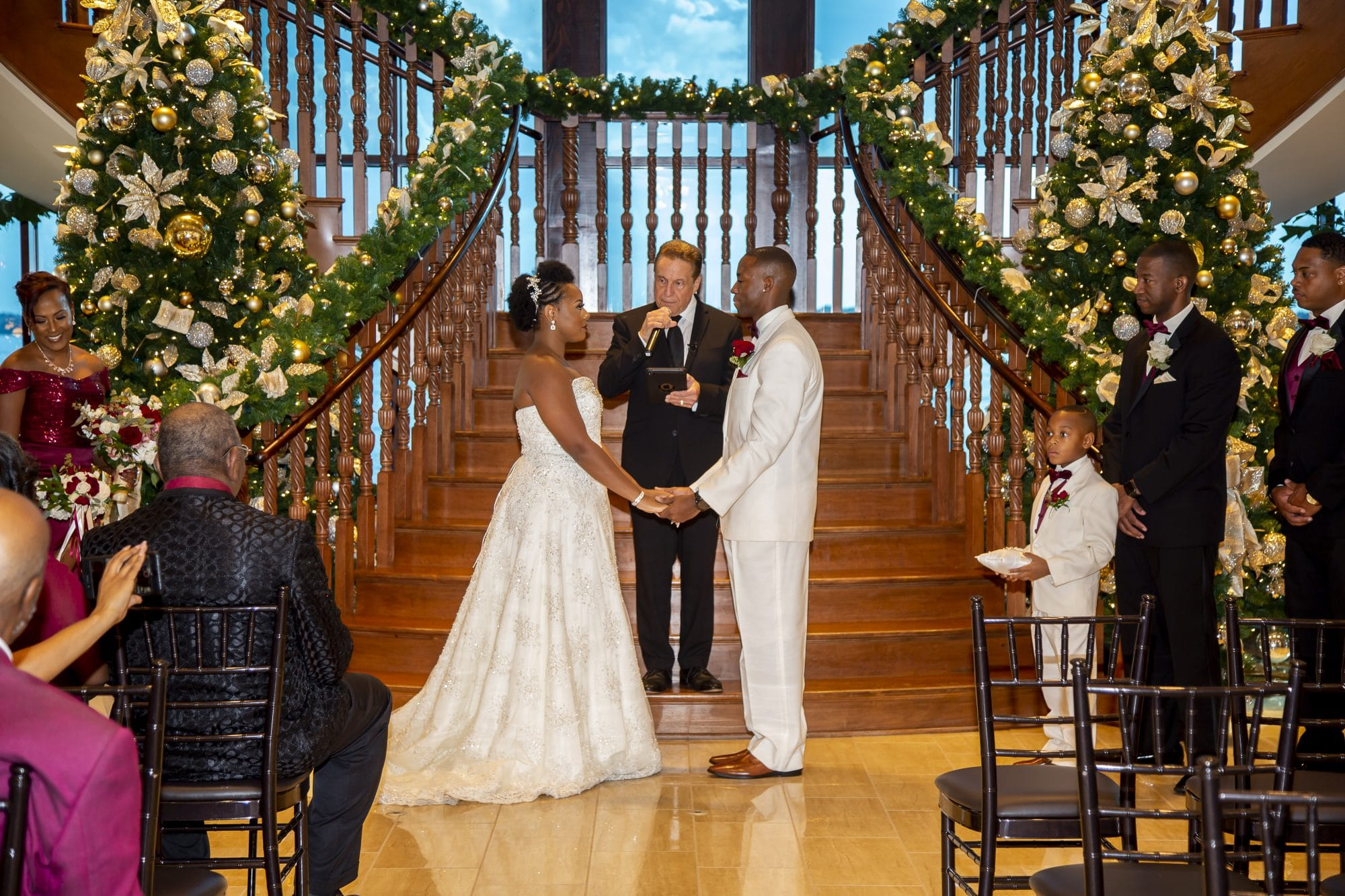 Shaneika and Richard saying their vows in front of gorgeous staircase