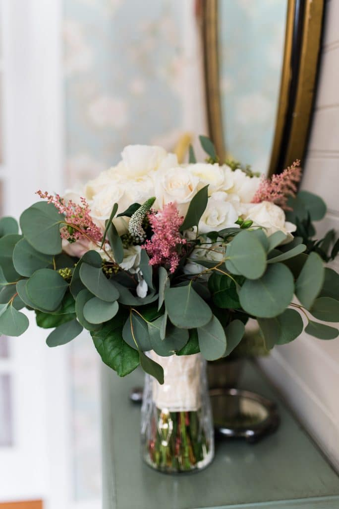 Beautiful bouquet with white roses and greenery