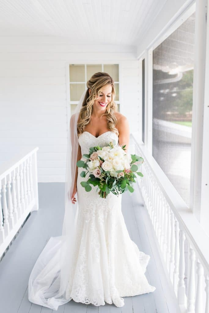 Gorgeous bride on covered porch
