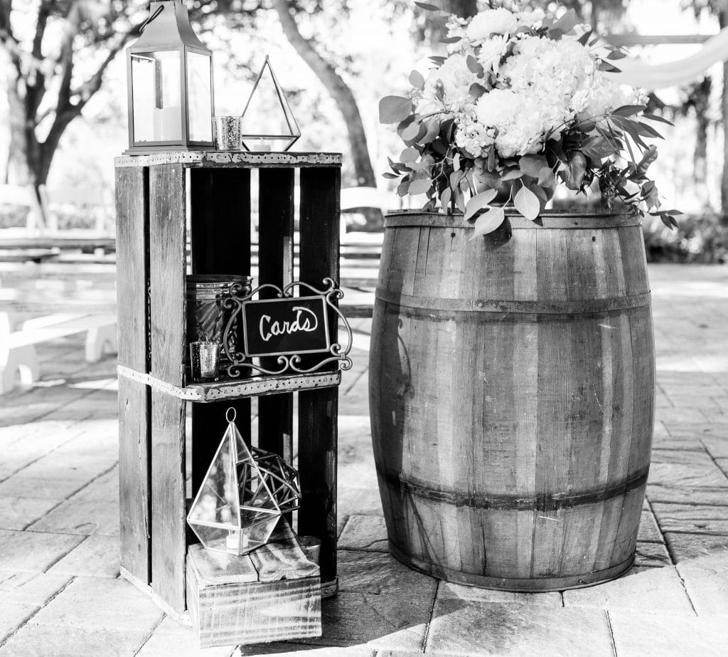 Black and white image of rustic outdoor ceremony decorations
