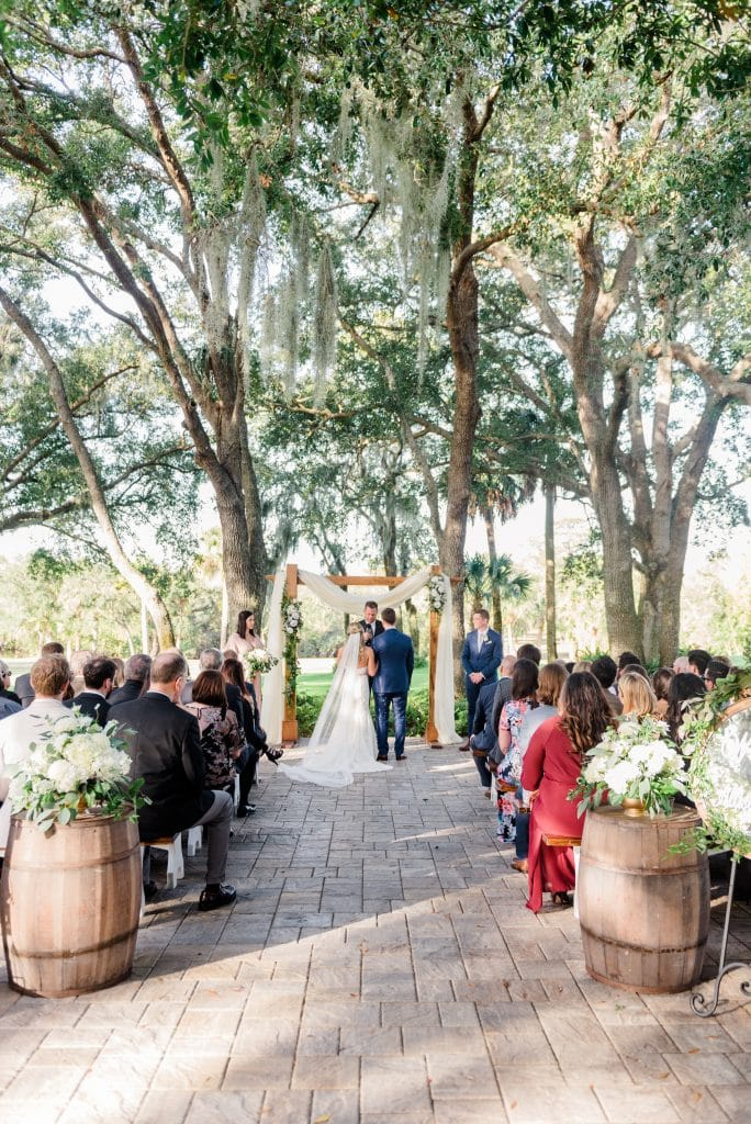 outdoor wedding ceremony under the trees at Up the Creek Farms