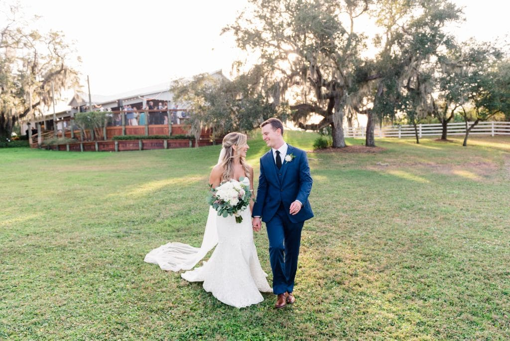 bride and groom in field in rustic Old Florida setting