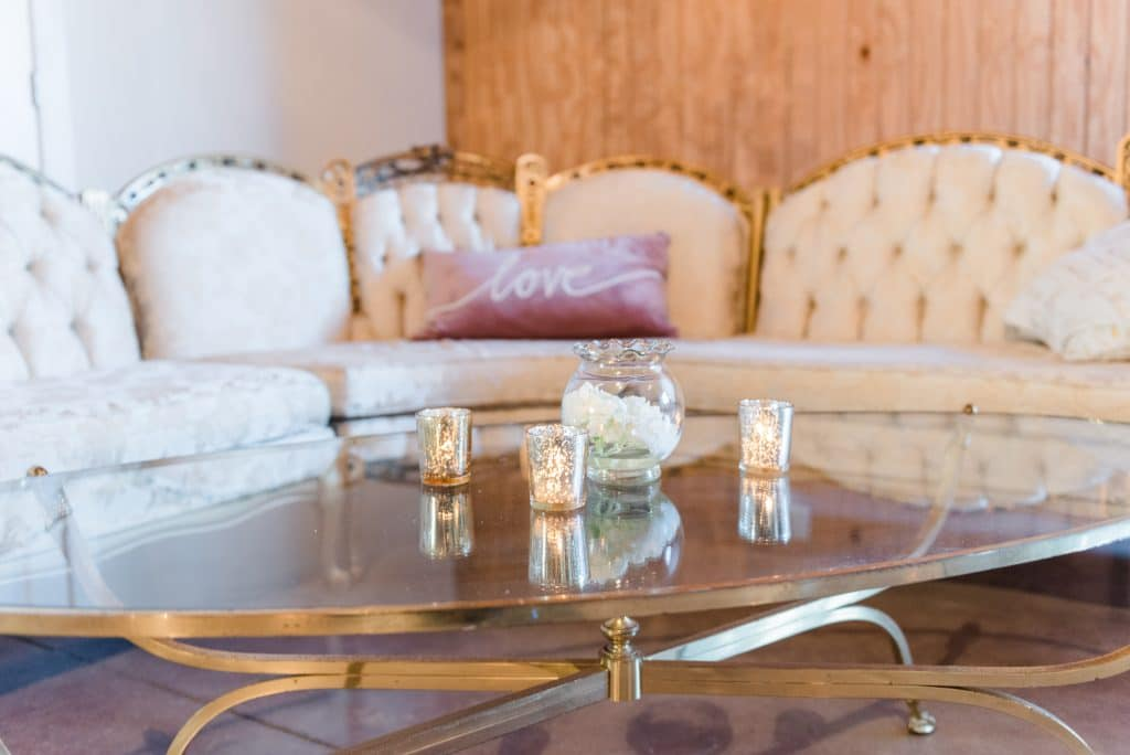 Mirrored table and couch at Up the Creek Farms