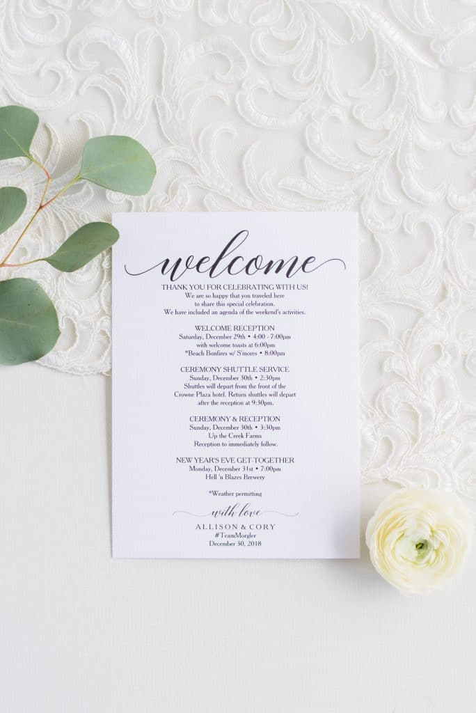 Flatlay photo of wedding welcome note and itinerary