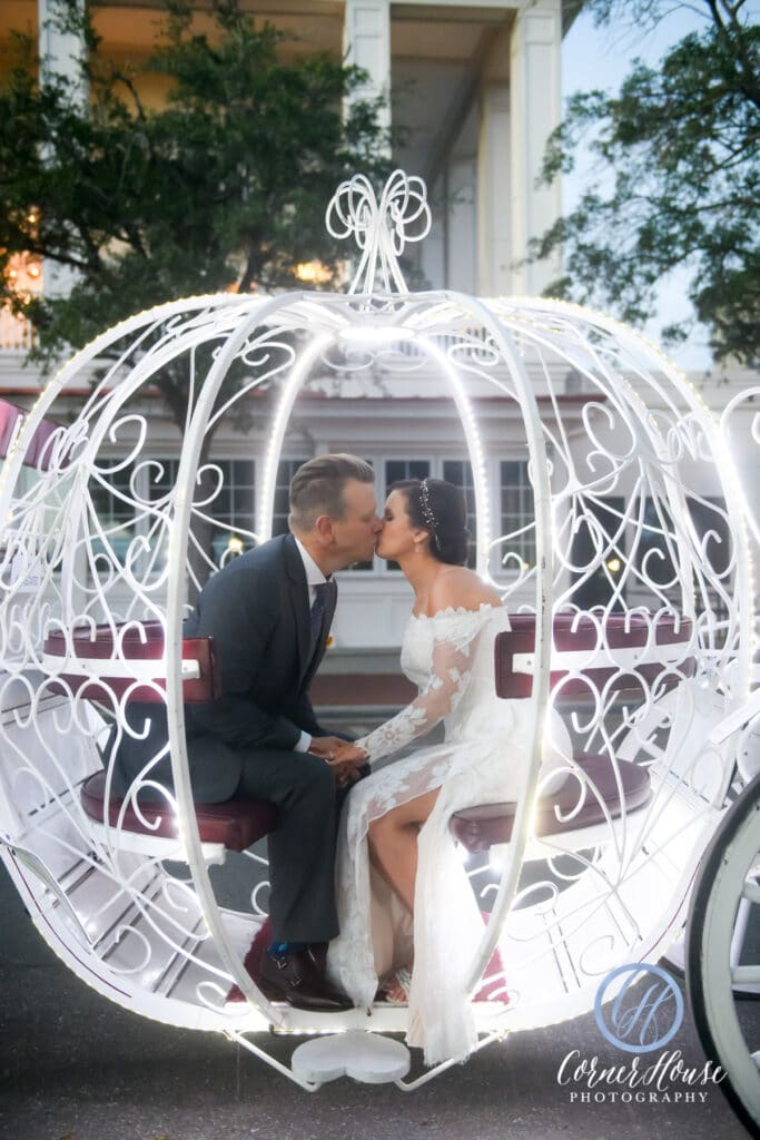 couple kissing in a carriage outside