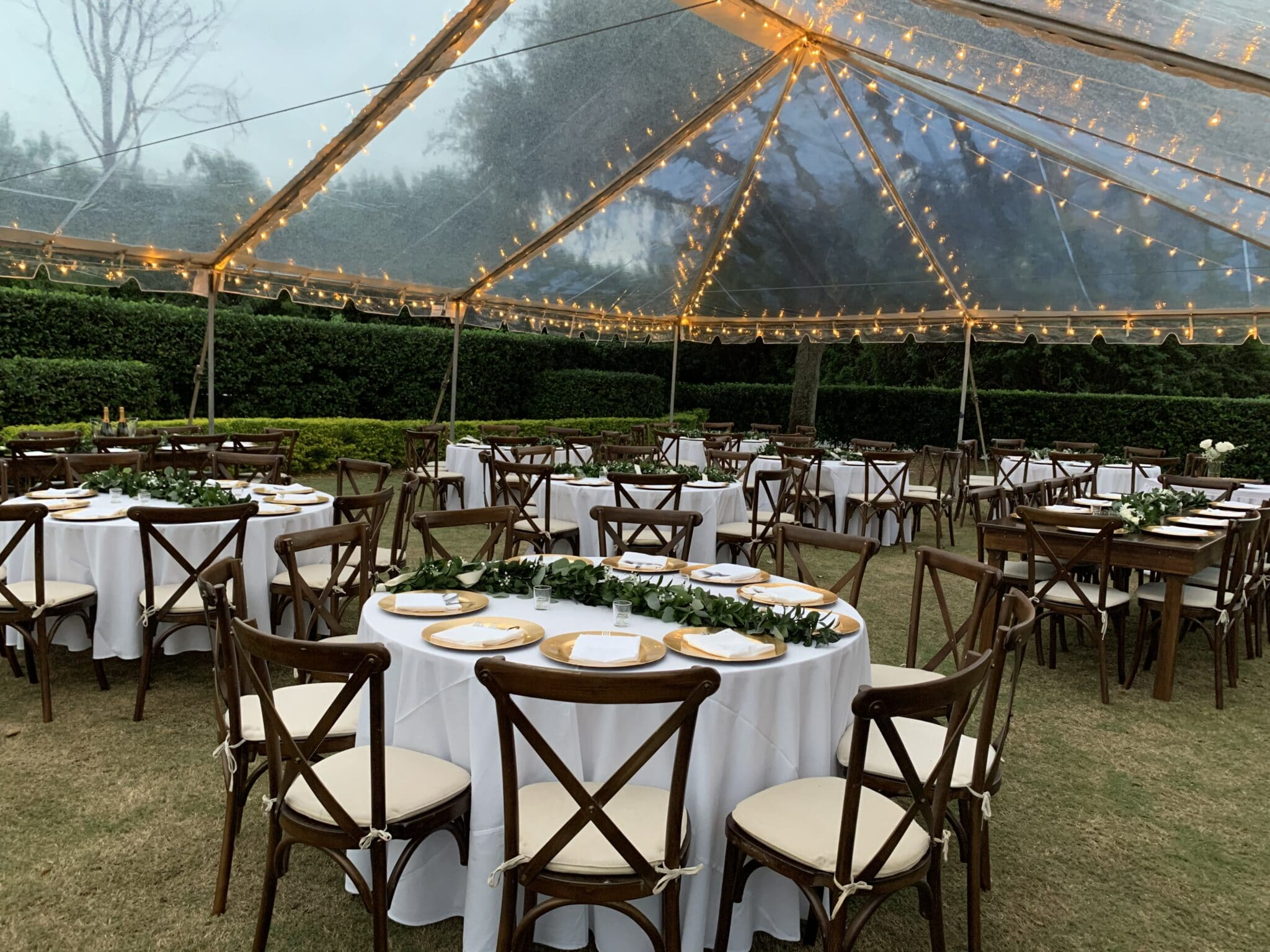 table set under a clear tent with lights