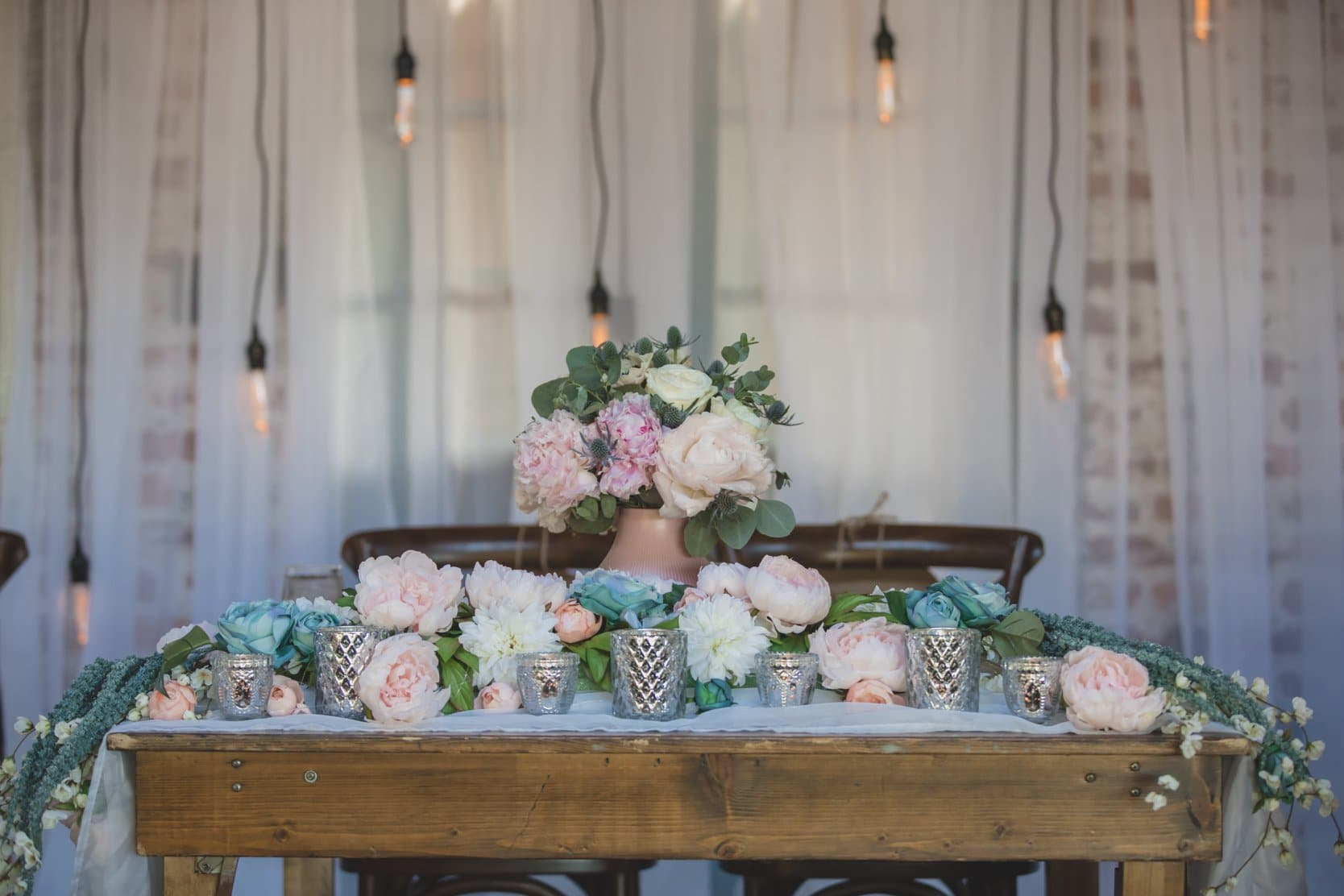 As You Wish - rustic sweetheart table covered in peonies