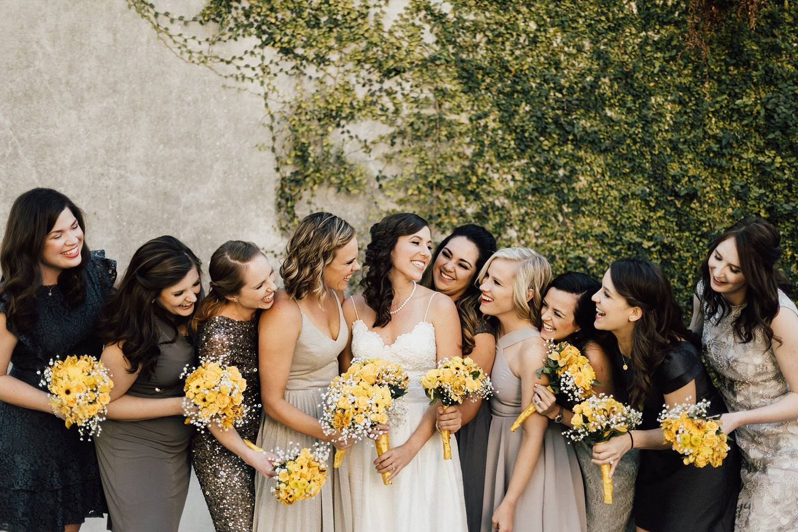 As You Wish - bride and bridesmaids in neutral colors with yellow bouquets