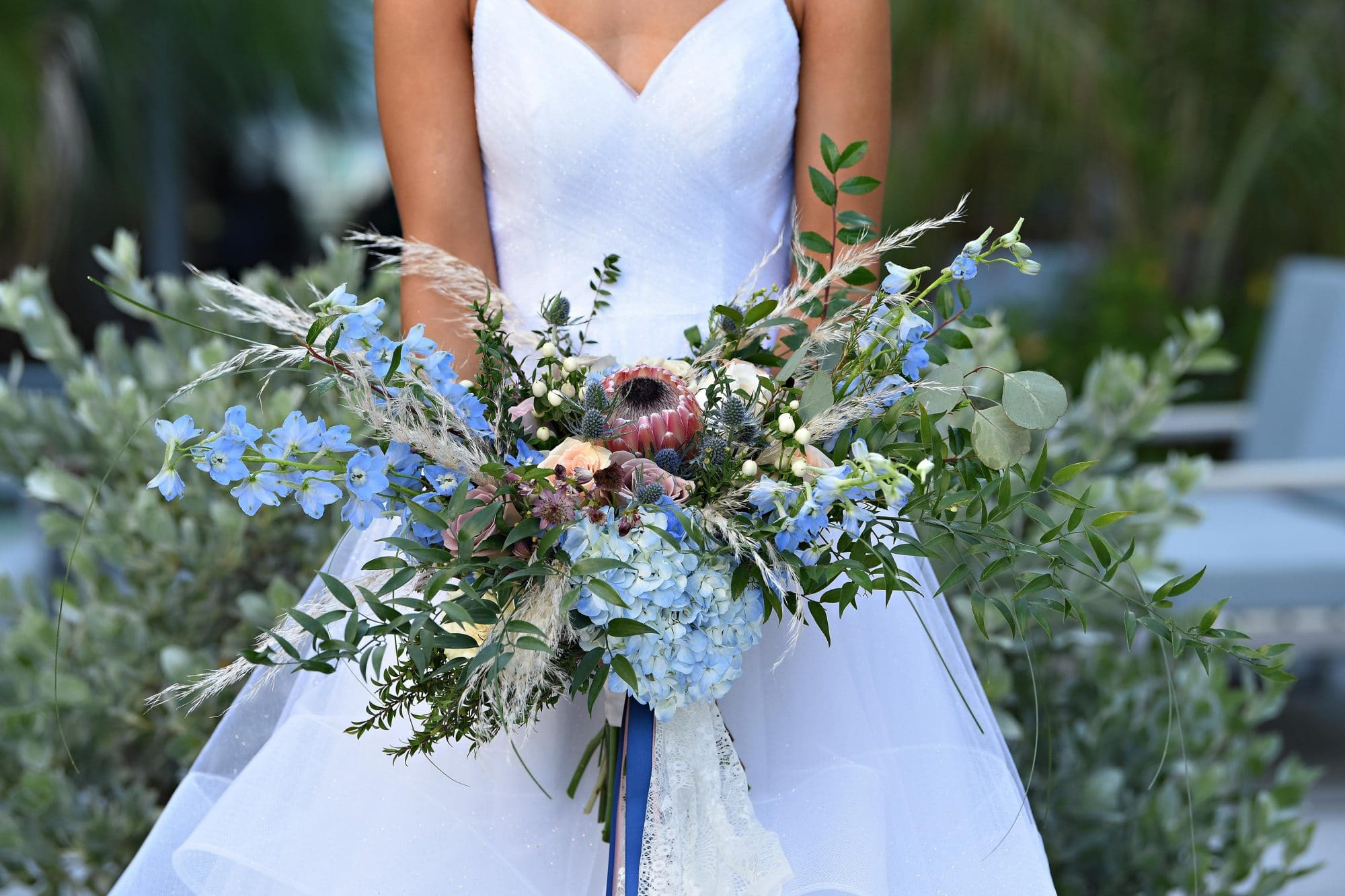 bride holding loose, sprawling bouquet