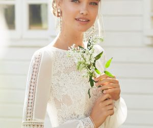 Bridal-Gallery-Couture-Bride holding small bouquet of babys breath in sunlight
