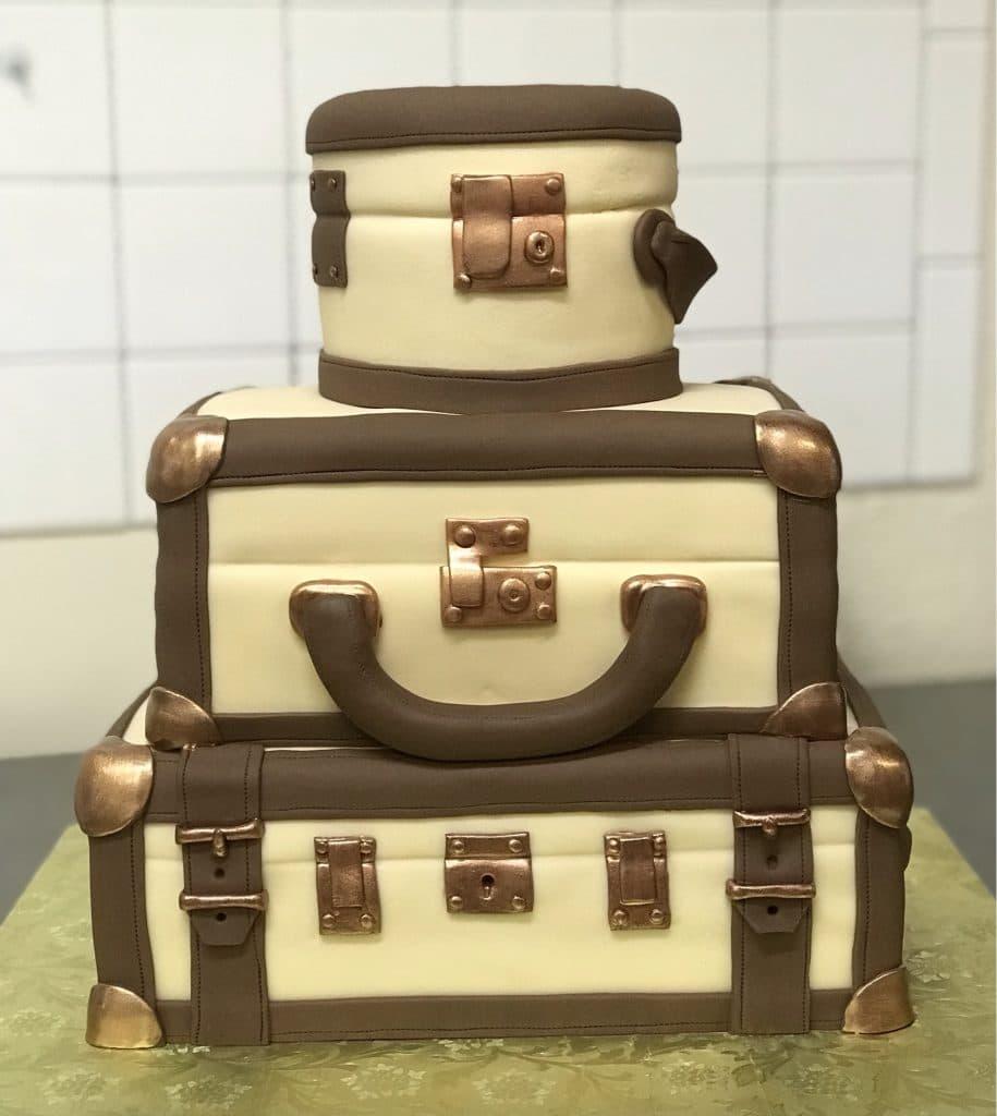 Cake & Bake - cake shaped like a stack of luggage