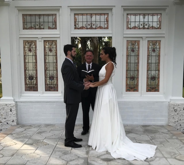 Cedar Knoll Events - wedding ceremony under white pergola with stained glass windows