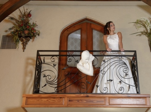 Cedar Knoll Events - bride on rustic indoor balcony