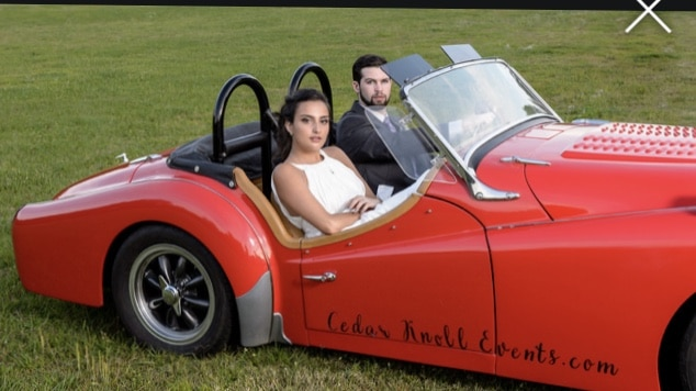 Cedar Knoll Events - bride and groom in cute racecar
