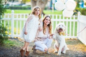 Alejandra Maddox of Everything Cake with daughter and dog