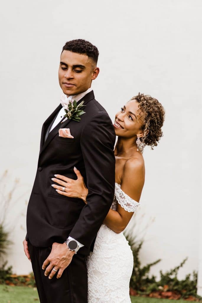 Josie Brooks Photography - bride hugging groom from behind