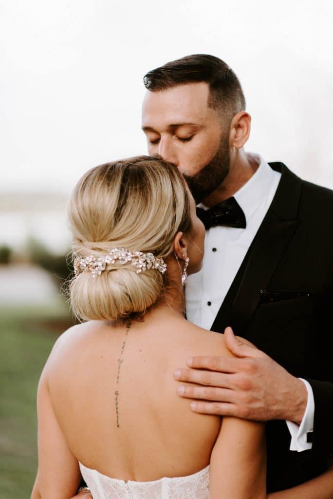 Josie Brooks Photography - groom kissing bride's forehead