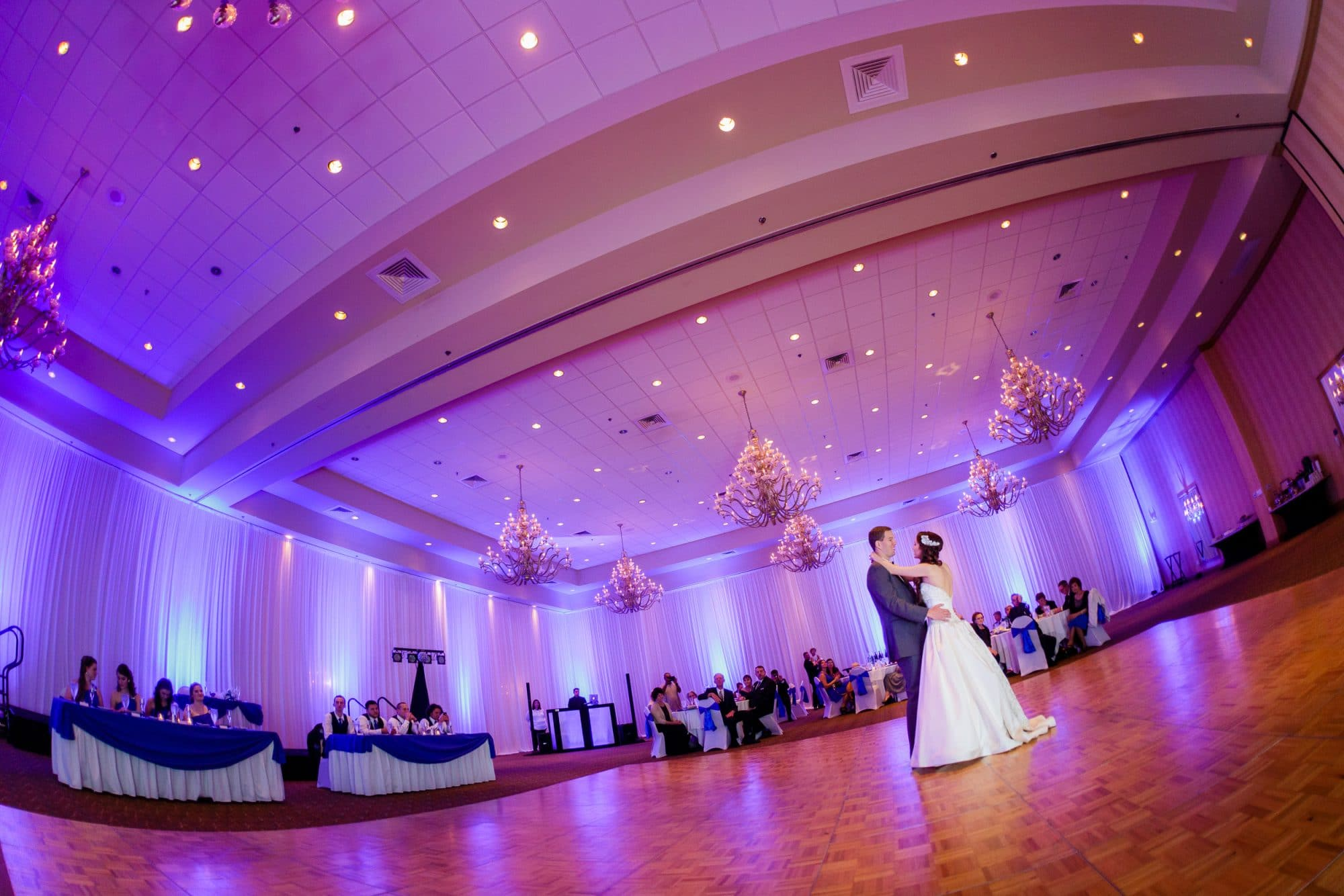 Steven Miller Photography - bride and groom sharing first dance in reception hall