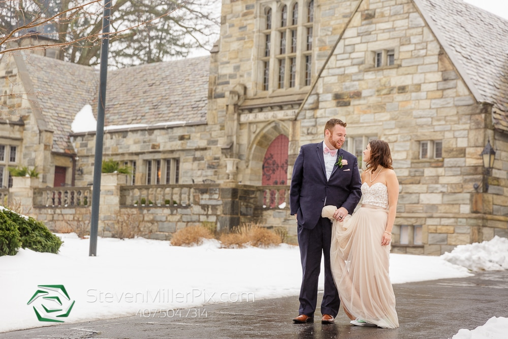bride groom outside church in the snow
