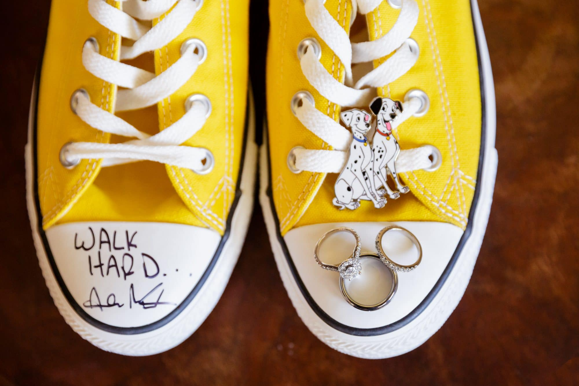 Steven Miller Photography- yellow sneakers with dalmation pin and rings arranged in Mickey Mouse shape