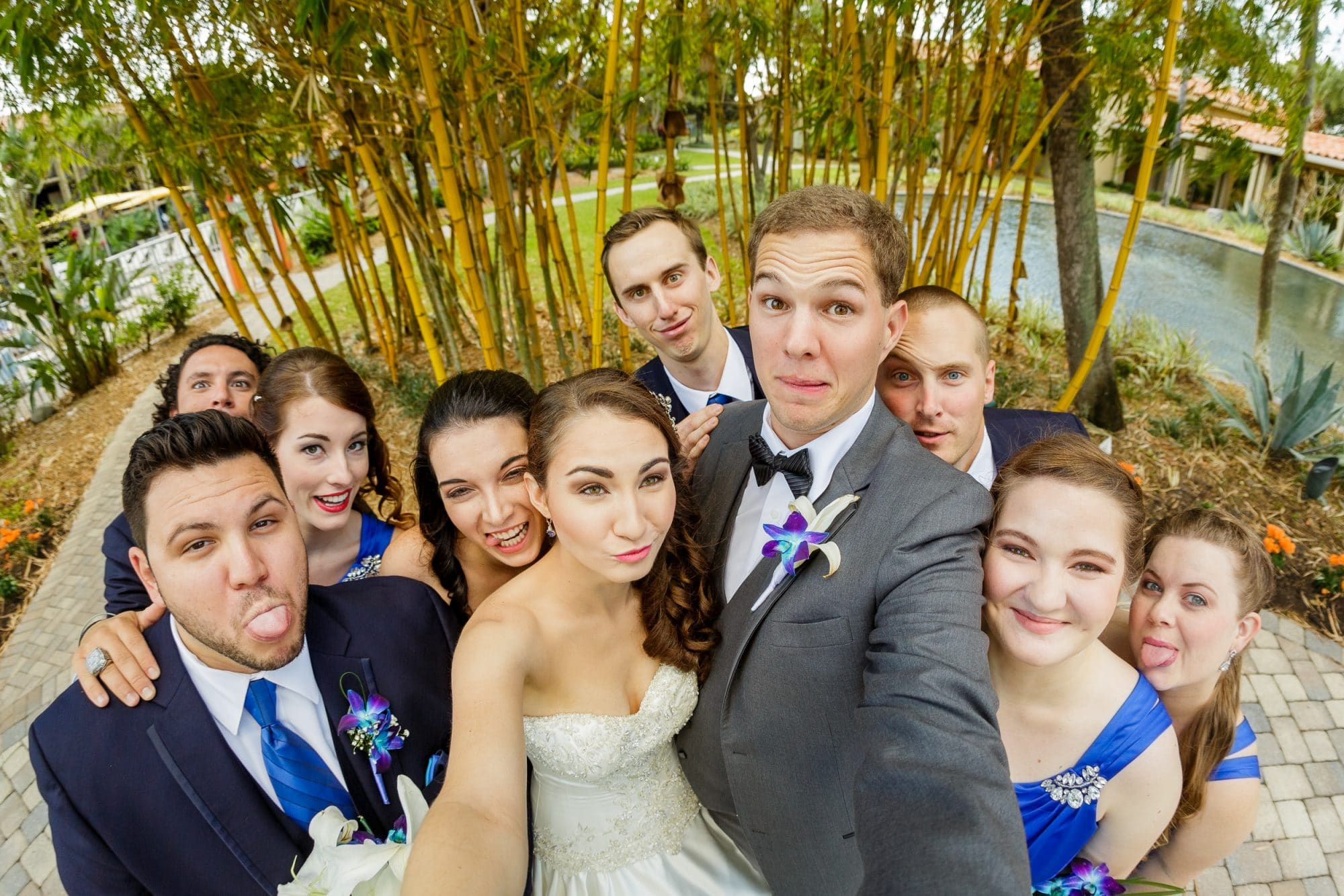 Steven Miller Photography - newlyweds and bridal party taking funny face selfie