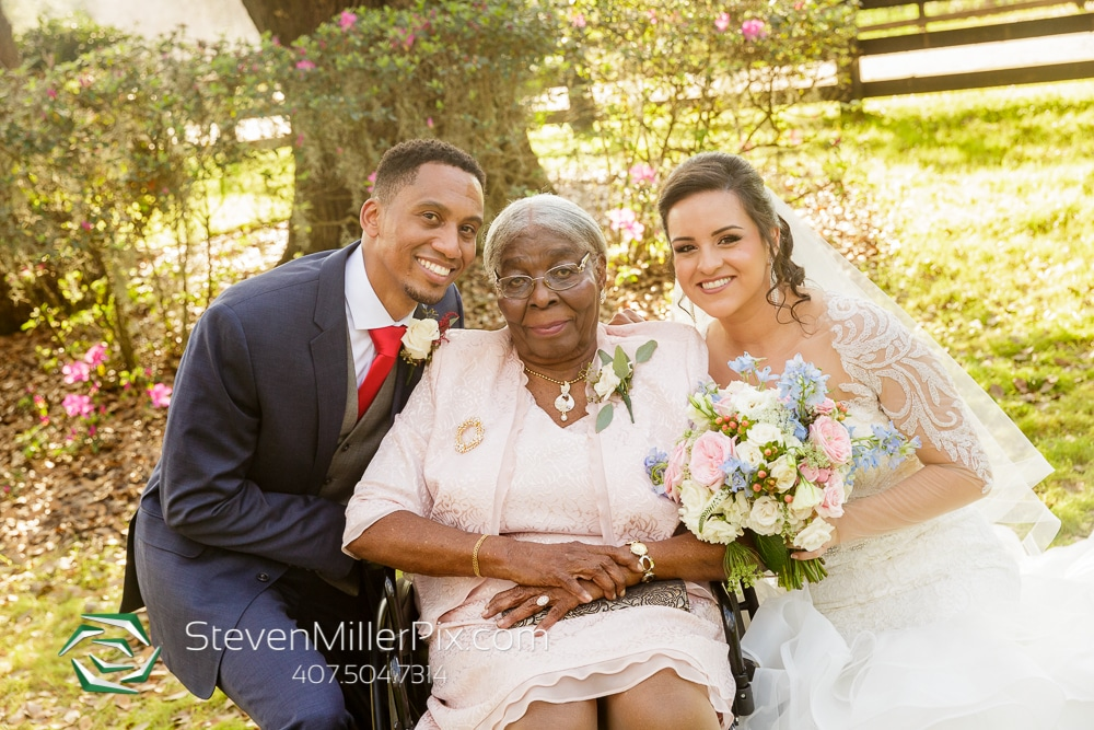 couple with grandmother outside