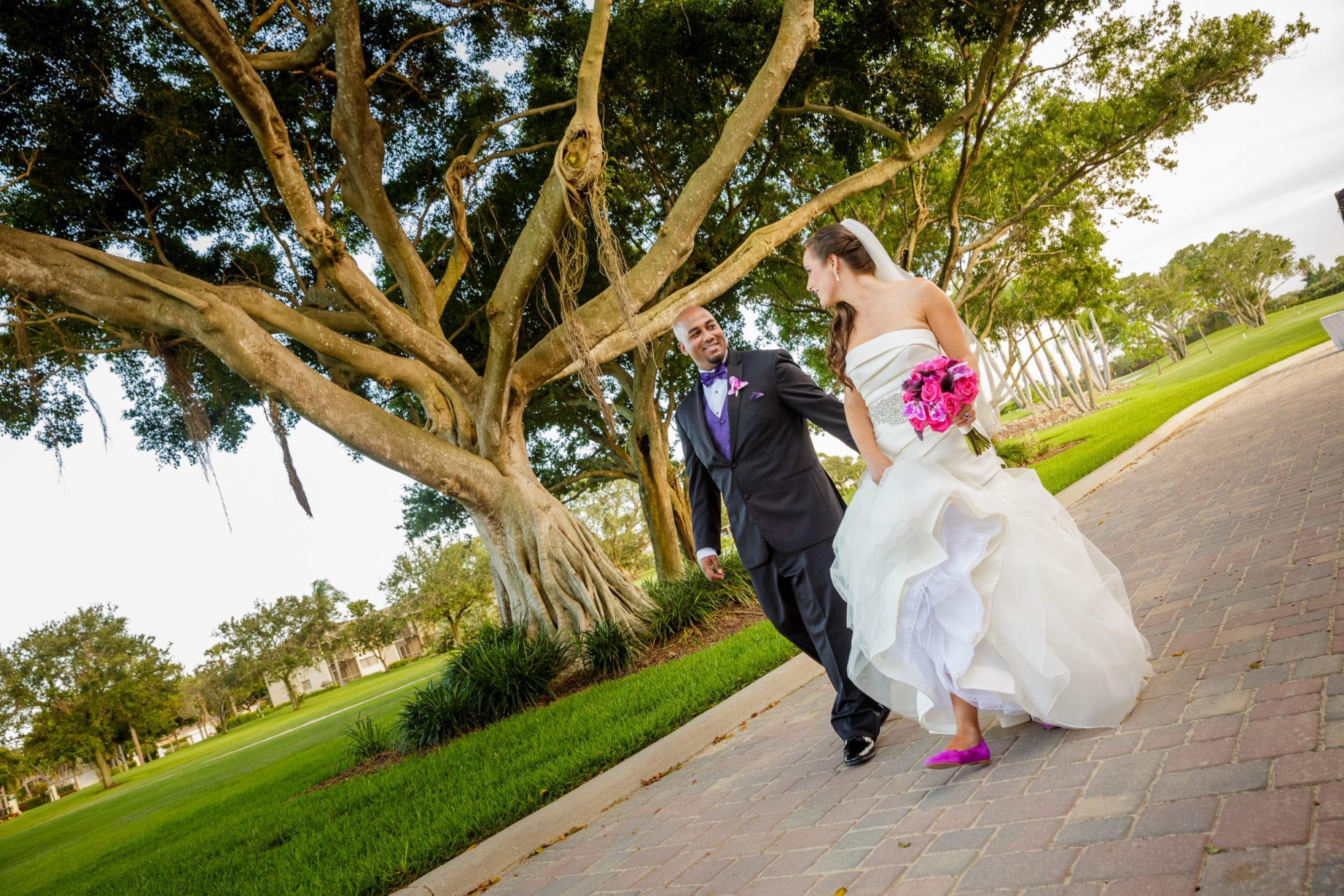 Steven Miller Photography- bride and groom holding hands while looking at each other.