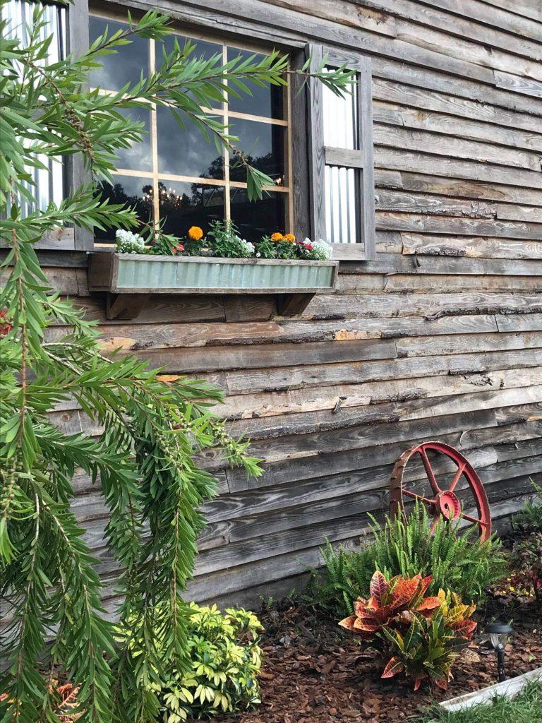 TrueHeart Ranch - window box of flowers in rustic barn