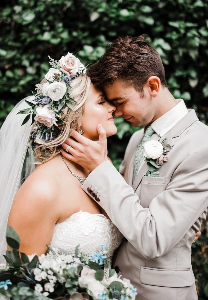 bride and groom touching foreheads