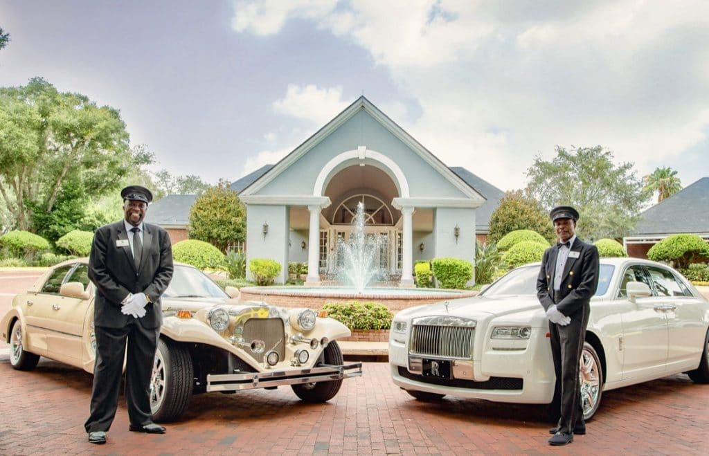 Exotic Limo - chauffeurs beside two gorgeous limos