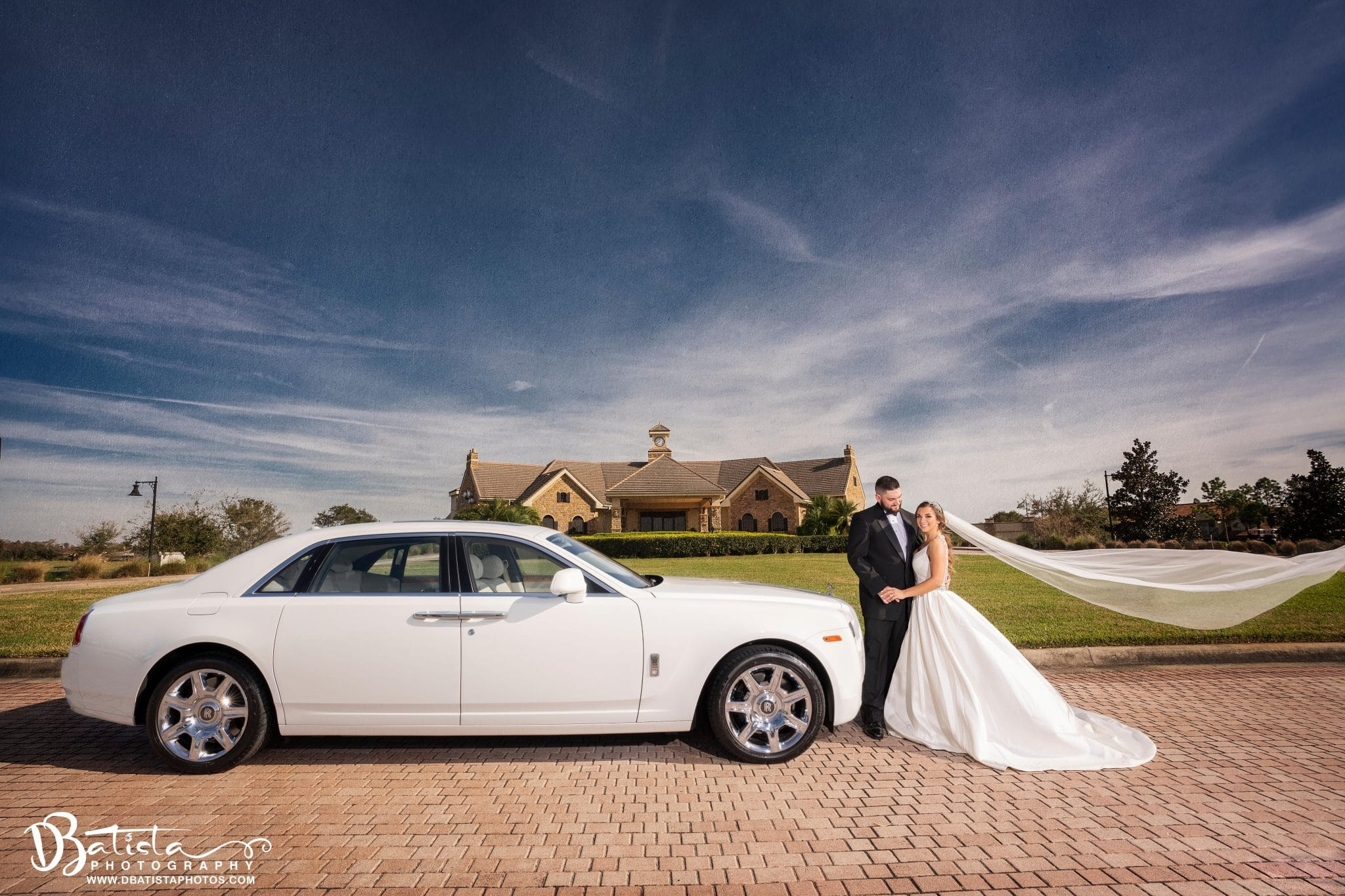 Exotic Limo - bride and groom next to beautiful white car