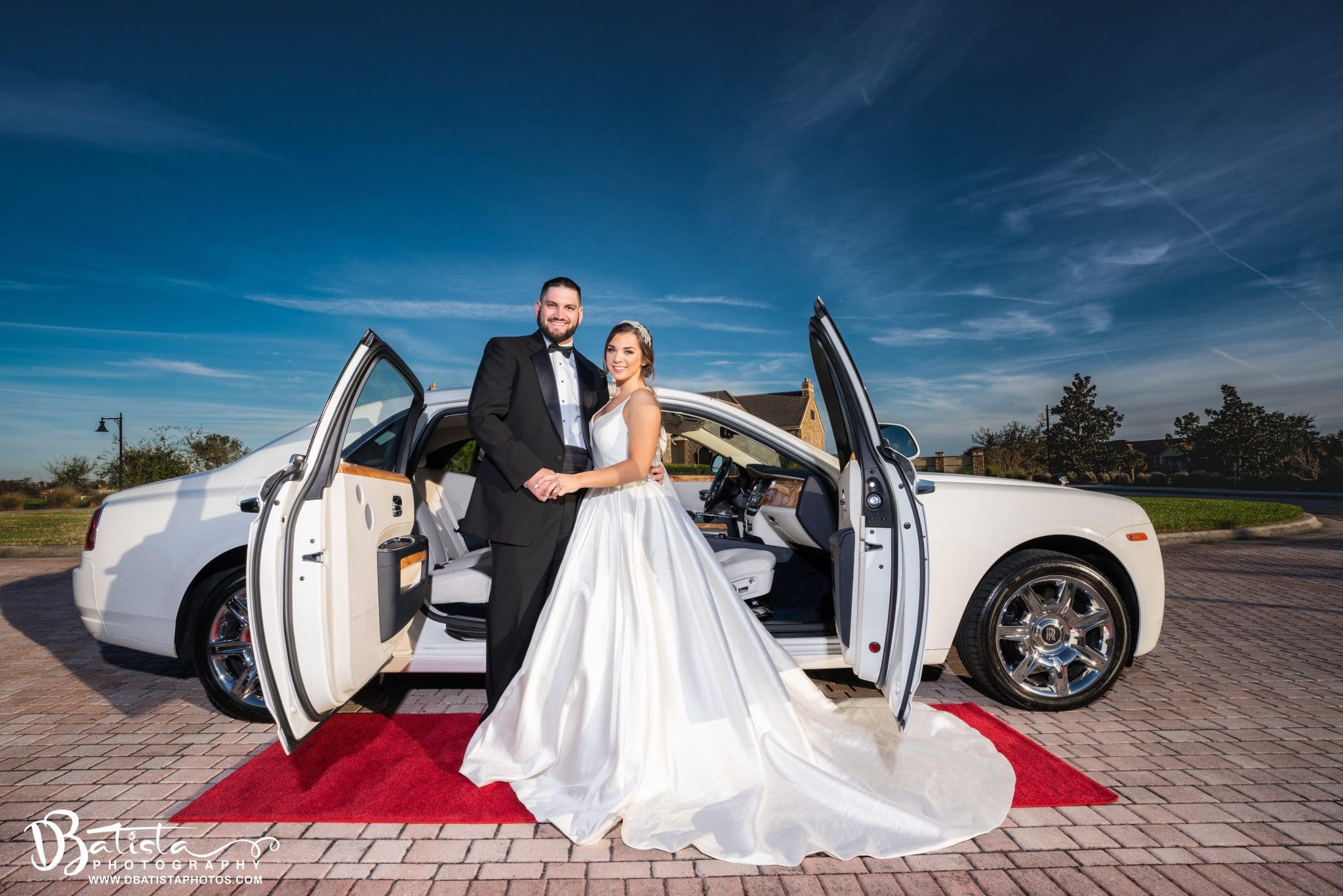 Exotic Limo - bride and groom next to limo