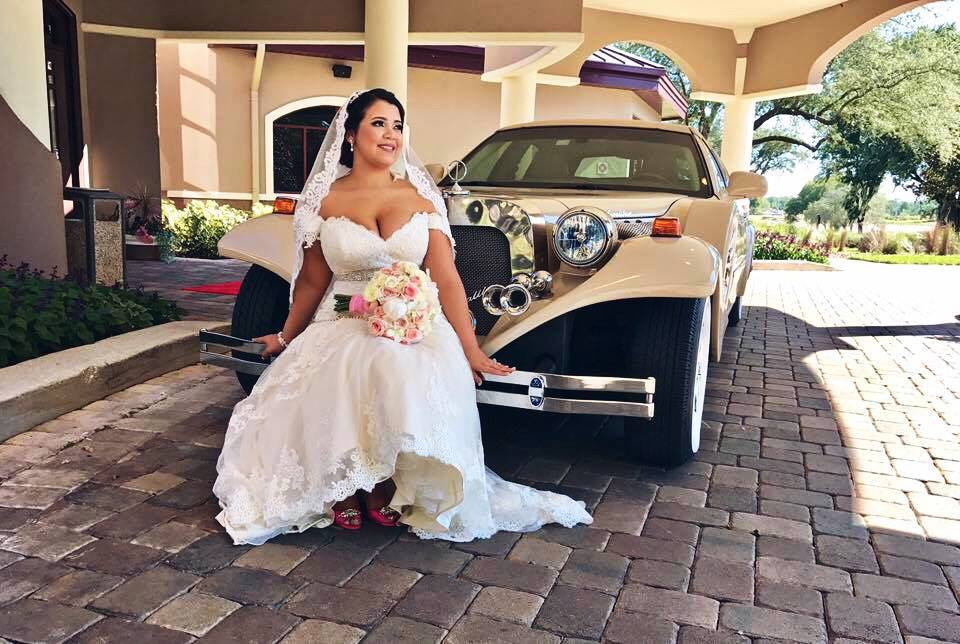 Exotic Limo - bride sitting on vintage limo