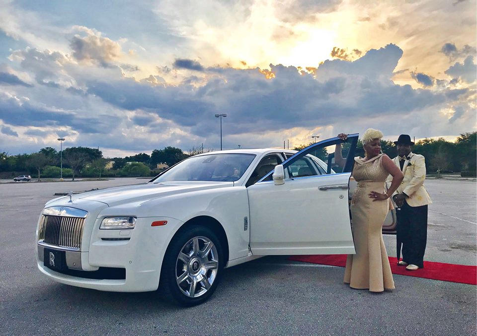 Exotic Limo - Couple next to upscale white limo