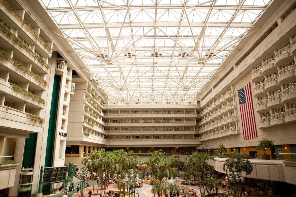 Hyatt-Regency-Orlando-Intnl-Airport-Middle of hotel with pool and seating