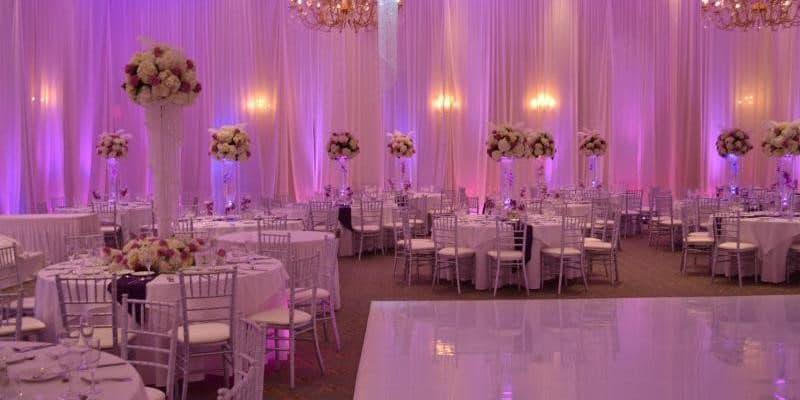 Hyatt-Regency-Orlando-Intnl-Airport-Ballroom set up for reception with purple and pink uplighting