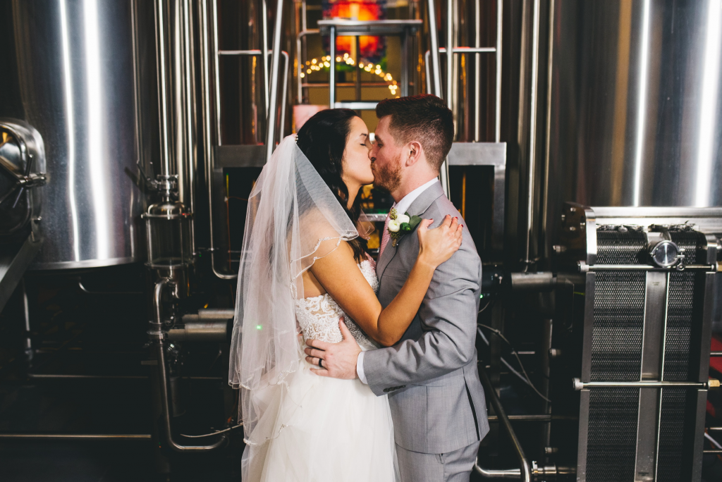 Brewhouse Kiss with bride and groom at Castle Church Brewery