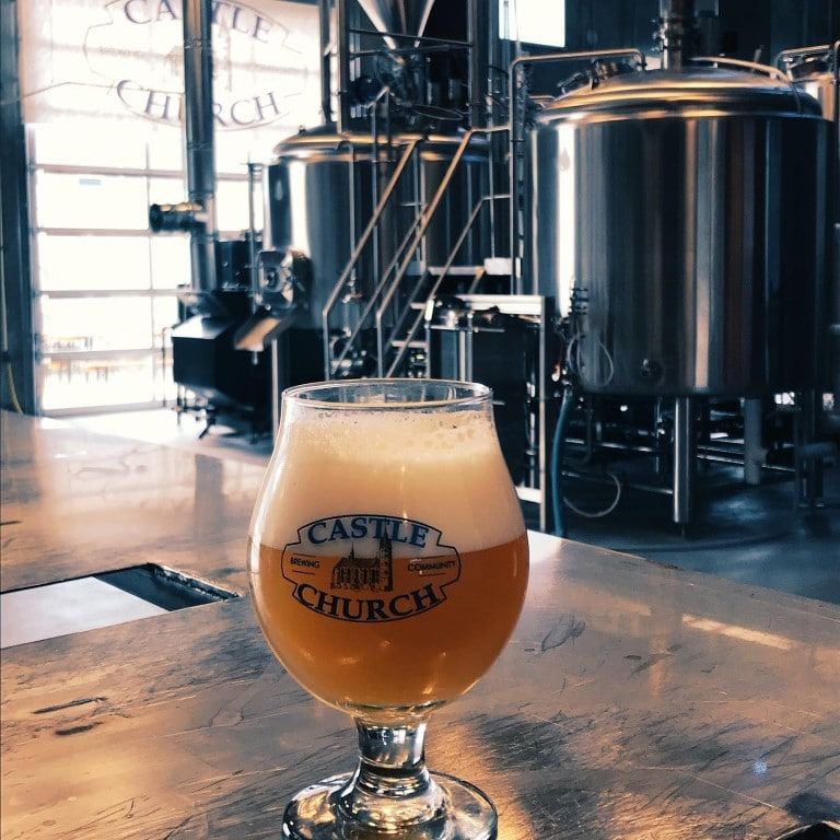 Castle-Church-Brewing-Draft beer in branded glass in brewery